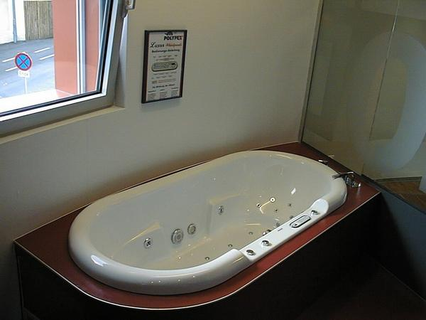Whirlpool in bath Exclusive detail in the bathroom: Bathtoob with whirlpool to show the connection between noble livestyle and solar energy.