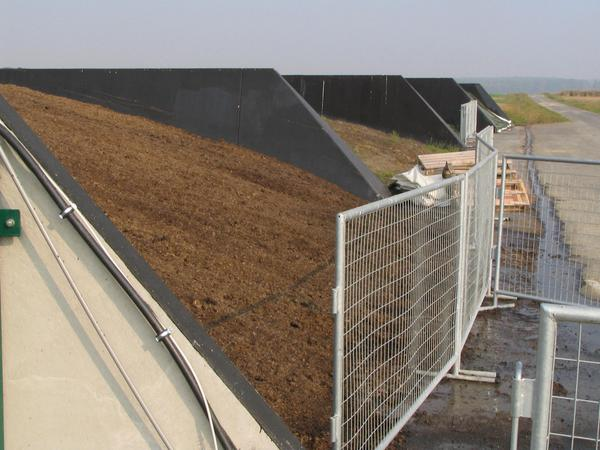Driving silo as a biomass depot 10,000 metric tons of biomass of the maize cultivation are delivered here per year in the driving silos. Each of 4 driving silos is 15 ms wide and 70 ms long.