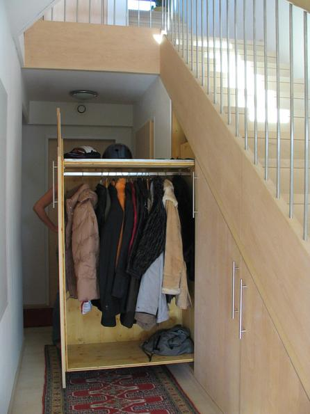 Wardrobe below staircase One movement and the wardrobe glides out below the staricase. In many prefabricated component houses are angled staircases where this is impossible.