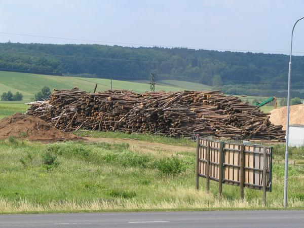 Wooden pile for the energy production Beside 2 MW powerplant is this wood pile. The wood comes from the region, the routes of transport are short and the efficiency high.