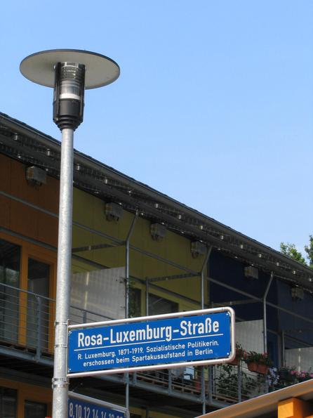 Rosa Luxemburg street in Freiburg The means of production in the hand of the whole population! The conversion of this ideal is behind the street sign: Photovoltaic roofs for the own production of electric power.