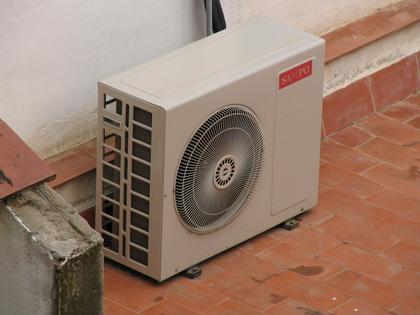 Cheap electric power for unprofessional solutions An omnipresent sight in southern lands. The back chill unity of an air-conditioning stands on a terrace and makes noise with the ventilating fan.