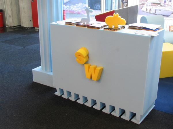 Exhibition stand of foam rubber CNC cut The column ant the bar shows the possibilities of the CNC cut equipment of Wegerich. Look at the slantwise cuted letters.