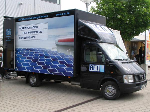 Goodbye Oil prices, the solar kings are coming On the outside of the fair shows the van from AET alternative energy technic the motto of the fair. Goodbye oil princes, here are the solar kings coming.