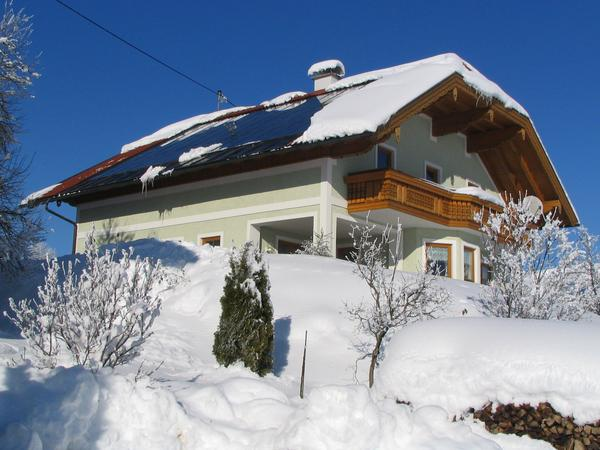 Solar collector snow free On the north side is like on all other houses about one half meter snow on the roof. But the snow can not perist on the large solar collector.